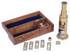 A mid 19th century brass drum microscope in fitted casewith two objectives, lenses and five specimen