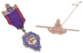 A 9ct gold military sweetheart pintogether with a silver gilt Order of the Odd Fellows jewell,