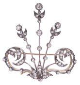 A Victorian diamond set aigrette brooch of stylised foliate design having three central diamond