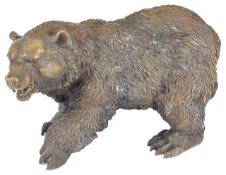 A large bronze figure of a grisly bear realistically modelled, in standing stance