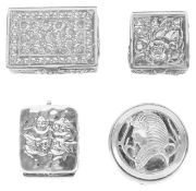 Three Contemporary silver pill boxes, 20th centurytwo embossed with flower heads and the other