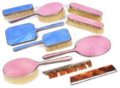 A suite of Mappin & Webb enamelled dressing table brushes and mirrorsa clothes and hair brush with