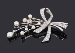 A good quality Continental diamond and pearl cocktail spray brooch, circa 1950formed as ribbon