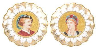 A pair of porcelain portrait plates, of scallop form with central painted portraits