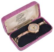 A 9ct Bravingtons gold ladies wristwatch, the engine turned gilt dial with arabic hours, spade