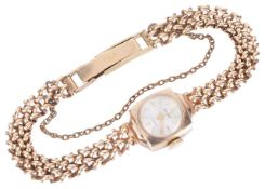 An Accurist 9ct gold ladies wristwatchthe circular dial with baton hours and facetted hands, in a