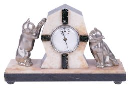 An Art Deco clockcentral clock in an alabaster and marble surround, flanked by two playful cats upon