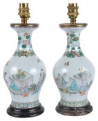 A pair of Chinese 19th century famille verte baluster vases converted to lampspainted with a