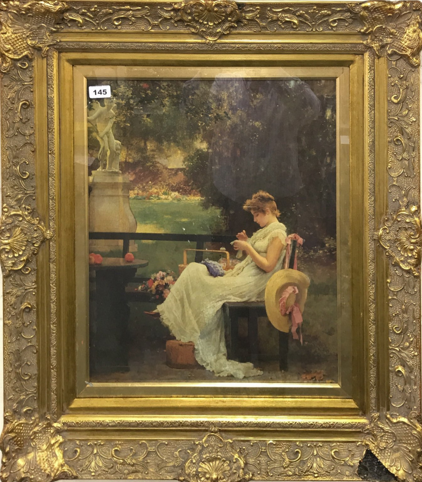 85b850c37b84 Lot 145 - A gilt framed oil finished print of a girl in a garden