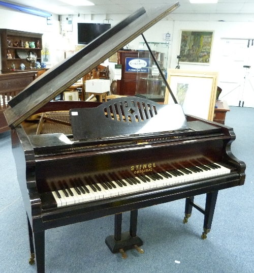 Lot 673 - A Stingl 'Original' Baby Grand Piano, No.30868, mahogany cased, on tapering legs with brass caps and