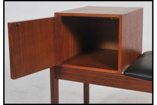 A Vintage Teak Wood Telephone Table Having Book Storage