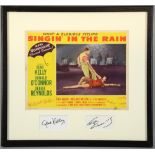 Singin' In The Rain (1952) US Lobby card, mounted with signatures of Gene Kelly & Cyd Charisse,