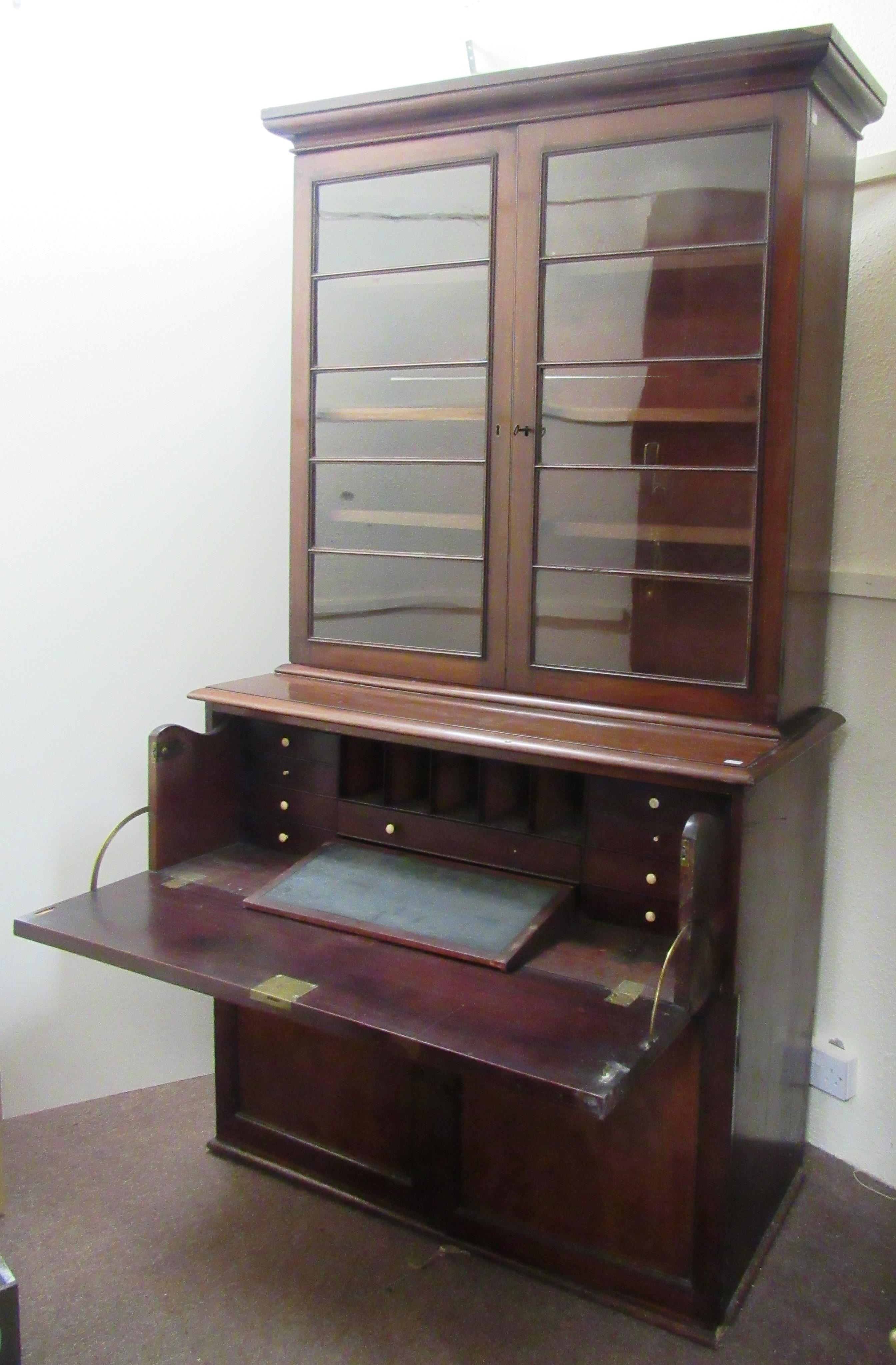 Flann O'Brien's Bookcase / Desk A large William IV period Irish mahogany Secretaire Bookcase,
