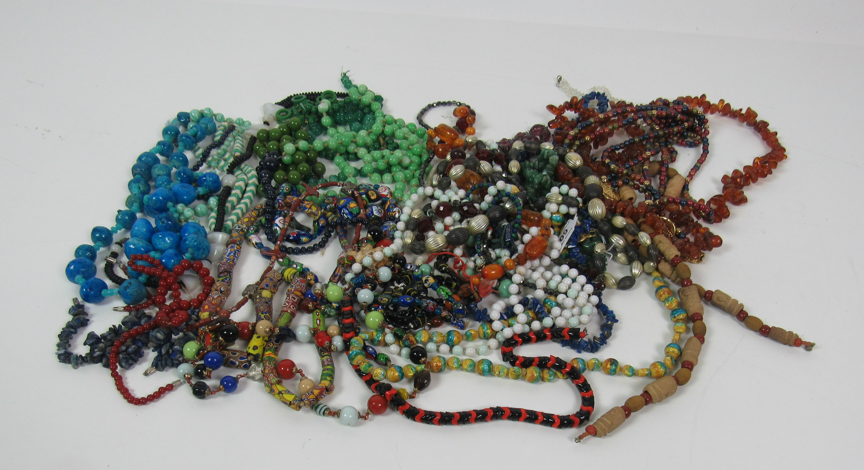 Lot 60A - Jewellery: A large box of colourful Costume Jewellery, over 30 bead necklaces,