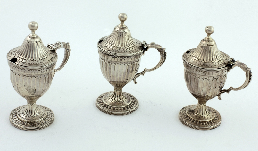 Lot 43 - A set of three Georgian period urn shaped Mustard or Condiment Pots,