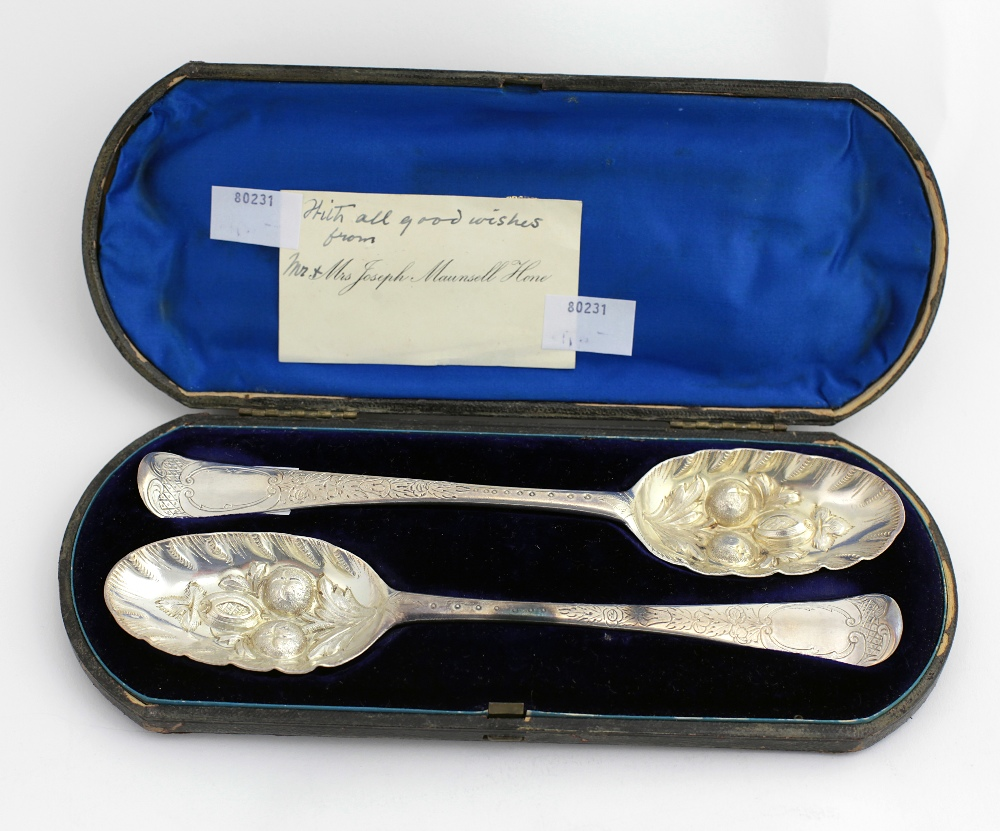 Lot 23 - A rare pair of early George III Irish silver Berry Spoons, Dublin 1763, by David Peter, approx.