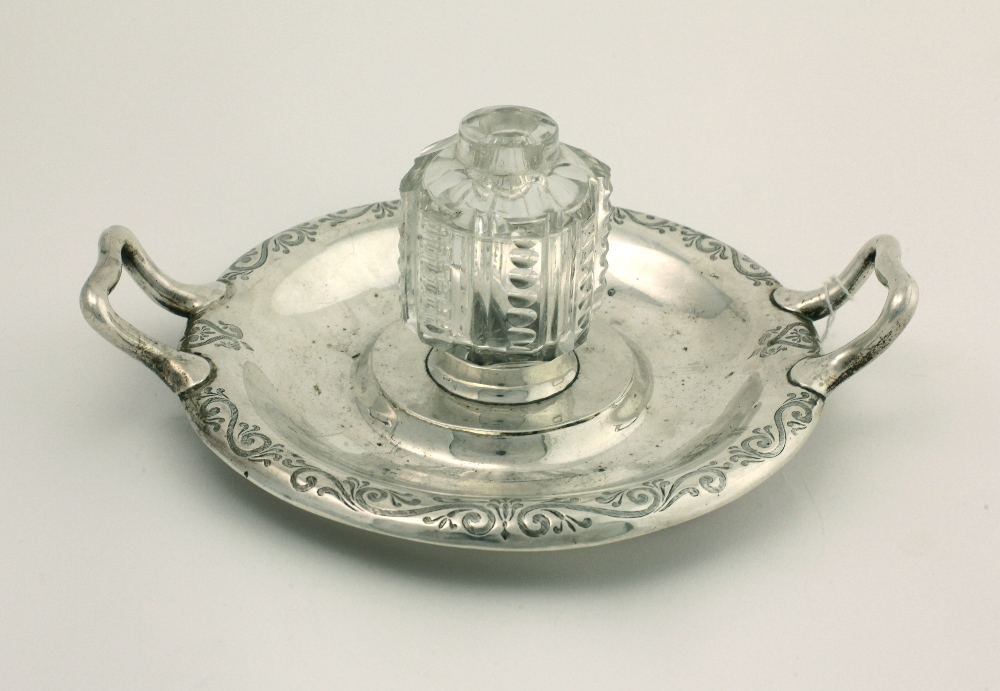 Lot 44 - An attractive early Victorian circular two handled silver Inkwell, with a moulded glass inset,