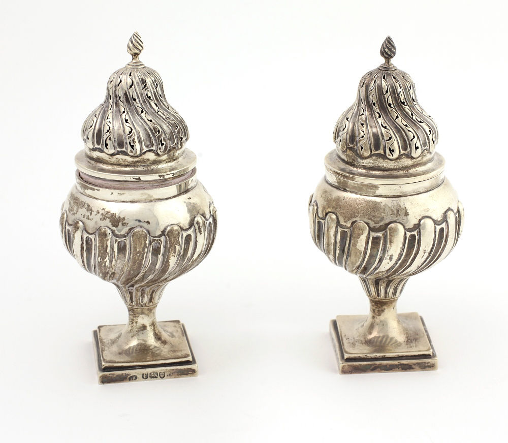 Lot 34 - A very unusual and important pair of large early George III English silver Sugar Castors, London c.