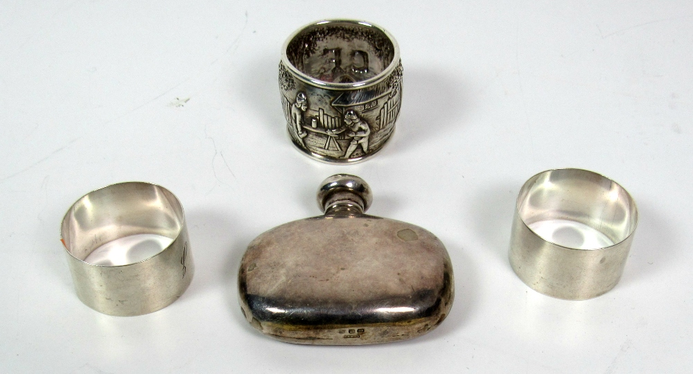 Lot 32 - A pair of plain Birmingham silver Napkin Rings, engraved 'G' & 'J',