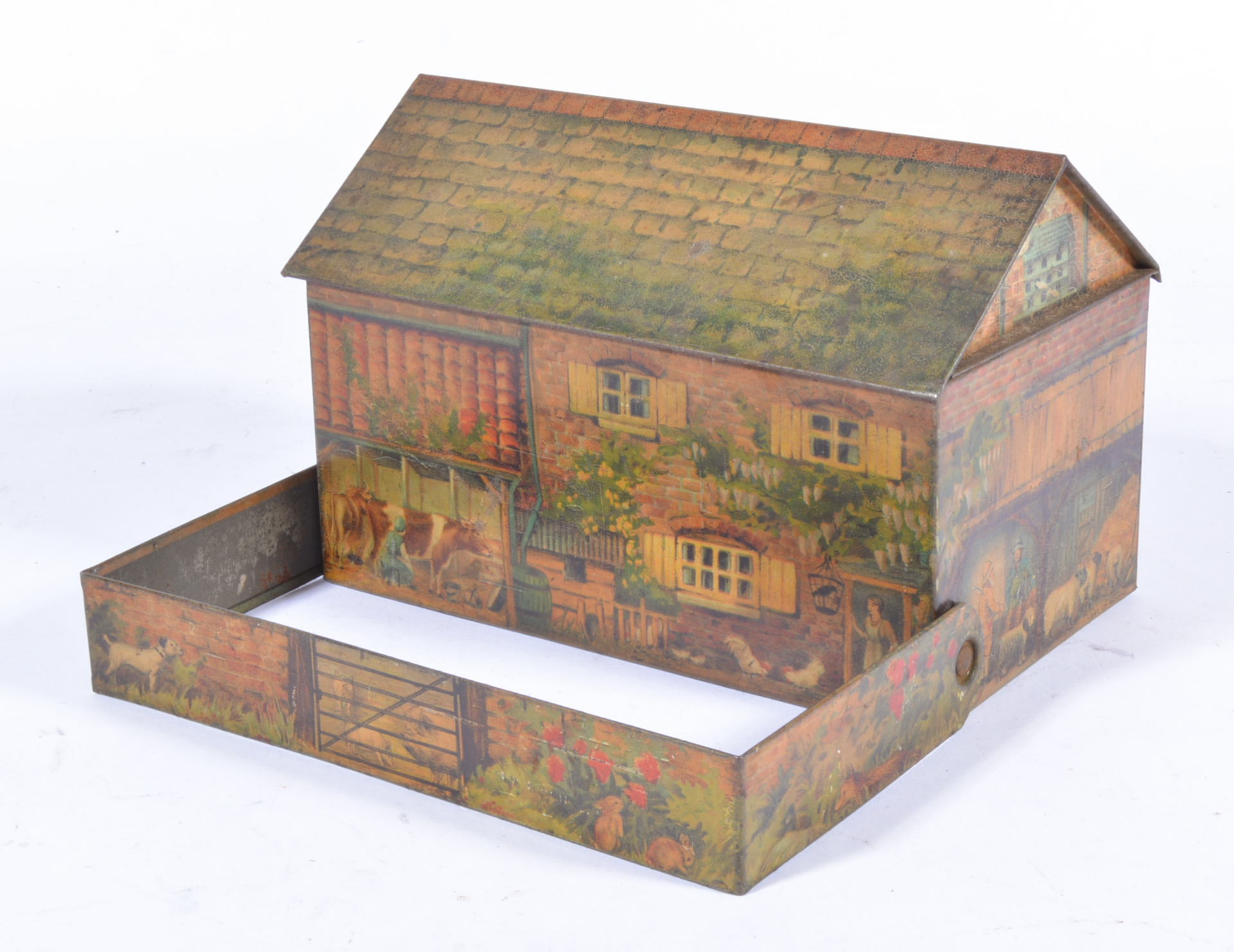 Huntley and Palmers biscuit tin, in the shape of a farmhouse with pull out hedge,