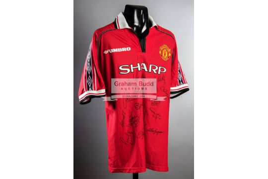 A multi-signed Manchester United 1999 Treble Winners jersey f89b9d4a7