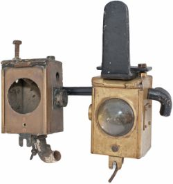 A pair of Bulleid locomotive brass headlamps, one complete with original lamp iron, the other