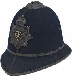 British Transport Policeman's helmet complete with original blackened BTC police helmet badge. In