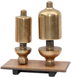A pair of GWR locomotive whistles, large and small, the large whistle is stamped GWR on the top.