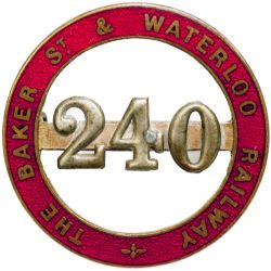 The Baker St. and Waterloo Railway enamel Cap Badge number 240. Brass with red enamel back marked