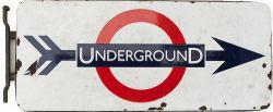 Underground enamel station direction sign, double sided with original mounting bracket. Some