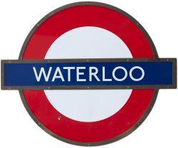 London Transport target/bullseye enamel sign WATERLOO mounted in original bronze frame on MDF.