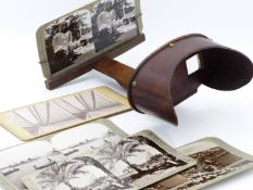 AN ANTIQUE STEREOSCOPIC VIEWER AND A COLLECTION CARDS WORLD TRAVELS, USA AND THE MIDDLE EAST.