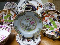A GROUP OF 19TH CENTURY ENGLISH IRONSTONE AND OTHER POTTERY PLATES , BOWLS, AND PLATTERS TO