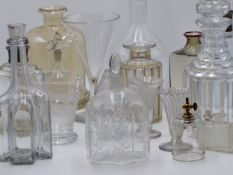 A GROUP OF EARLY 19TH CENTURY AND LATER CUT AND ETCHED GLASS DECANTERS, VASES AND OTHER VARIOUS