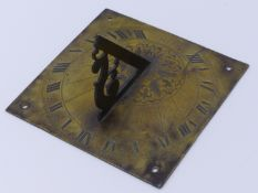 AN ENGLISH BRASS SUNDIAL, BEARS DATE 1687 WITH ROMAN NUMERAL CHAPTER AND LEAF ENGRAVED CENTER, THE