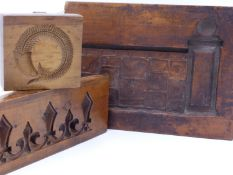 THREE 19TH CENTURY FRUITWOOD MOULDS FOR GESSO DECORATIONS. LARGEST 38 1/2 CM