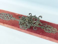 A LARGE 17TH CENTURY WROUGHT IRON DOOR HANDLE / KNOCKER WITH FOLIATE SCROLL AND MASK ENGRAVED