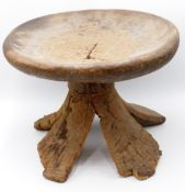 A COLLECTION OF SIX VARIOUS WEST AFRICAN CARVED WOOD STOOLS. LARGEST 35 CM DIAMETER.