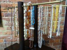 TWENTY TWO TRIBAL AND OTHER NECKLACES STRUNG WITH SHELL, STONE AND BONE BEADS AND A QTY OF VARIOUS