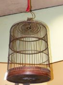 A CHINESE BAMBOO LARGE HANGING BIRDCAGE TOGETHER WITH A BAMBOO FISH TRAP (2)