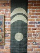 TWO JAPANESE BATIK SCROLL PANELS WITH CRESCENT AND CIRCULAR MOTIFS.