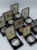 A GROUP OF ROYAL MINT COMMEMORATIVE SILVER 5 OUNCE (TROY) COINS AND MEDALS TO INCLUDE FALKLANDS,