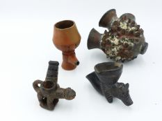 FOUR AFRICAN POTTERY SMOKING PIPE BOWLS