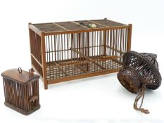A CHINESE BAMBOO LARGE TWO COMPARTMENT CRICKET CAGE, WHITE METAL SUSPENSION AND CHAIN HUNG WITH