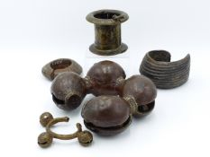 A HEAVY BRONZE AFRICAN BELL ANKLET, A SIMILAR BRACELET, TWO FURTHER BRONZE BRACELETS AND A HINGED ""