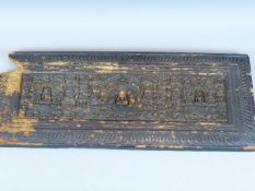 AN ANTIQUE ORIENTAL BUDDHISTIC CARVED WOOD PANEL DEPICTING THREE ENSHRINED BUDDHA AND ATTENDANT