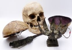TWO BONE SKULL KAPALA, ONE WITH RED DYED INTERIOR AND LEATHER STRAP TOGETHER WITH A FULL HUMAN