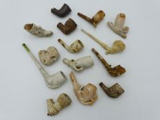 A COLLECTION OF ENGLISH AND EUROPEAN CLAY PIPES AND PIPE BOWLS.