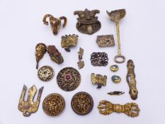 A GROUP OF ORIENTAL GILT BRONZE, BRASS AND SILVER MOUNTS, CHINA, TIBET AND JAPAN, 17TH CENTURY AND