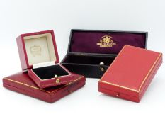 A CARTIER RED LEATHER AND GILT TOOLED RING BOX, A SIMILAR PENDANT BOX, A JW BENSON PRESENTATION